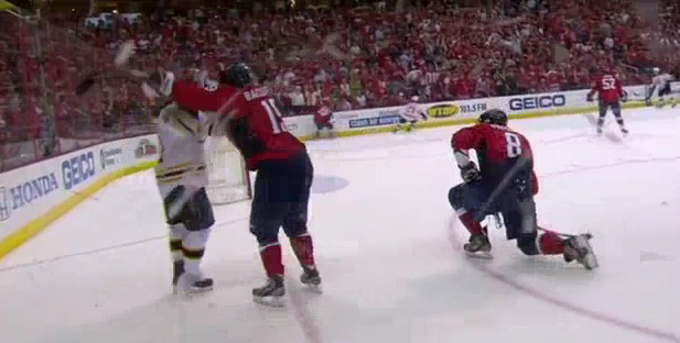 Backstrom cross-checks Peverly in the face