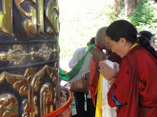Lama Zopa Rinpoche and Khadro-la consecrating the finished large prayer wheel at Land of Medicine Buddha, June 2012.
