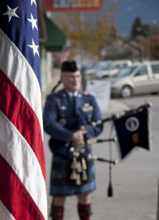 Ronan resident James Pettit, who served in the Air Force during Operation Desert Storm, pauses with his bagpipes on Main Street in Ronan Friday. Pettit honors Veterans' Day each year by playing his pipes while walking a lap downtown. Photo by Will Freihofer.