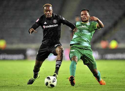 Linda Mntambo of Orlando Pirates feels the pressure from Baroka's Goodman Mosele during their Absa Premiership match at Orlando Stadium last night.