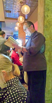 At DaNet, Vitaly Paley reads to us about kulebyaka before the big presentation of the DaNet Third course. Kulybyaka (King Salmon with Sturgeon Cheek Porcini Pie with morel and sour cream dill sauce and viziga cracklings) is presented before it is cut for individual plate service