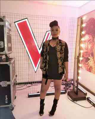Yemi Alade cleavage baring outfit