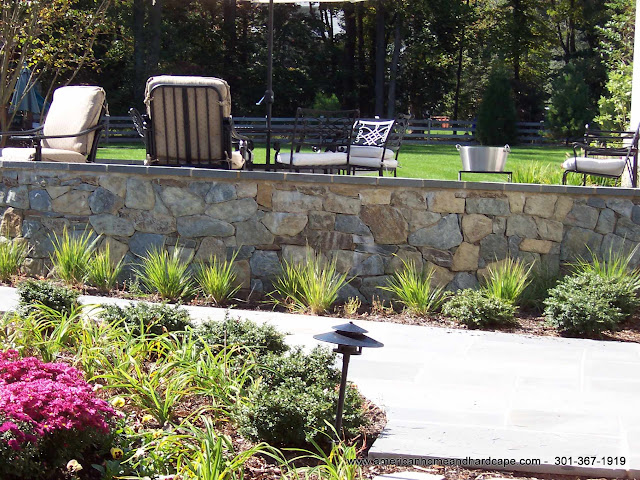 Stone retaining wall in Bethesda, MD.  Stone retaining walls are used primarily for hardscape design.