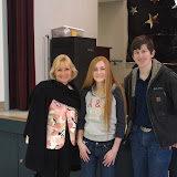 Cardinal Newman Interact members Paige Amormino, CN '15 and Josh Gluch, CN '13 delivering dictionaries to third graders at Riebli School with school principal Mrs. Fran Hansell.