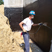 Hydra-Guard waterproofing material spans cracks in foundations to stop water leaks into the basement.