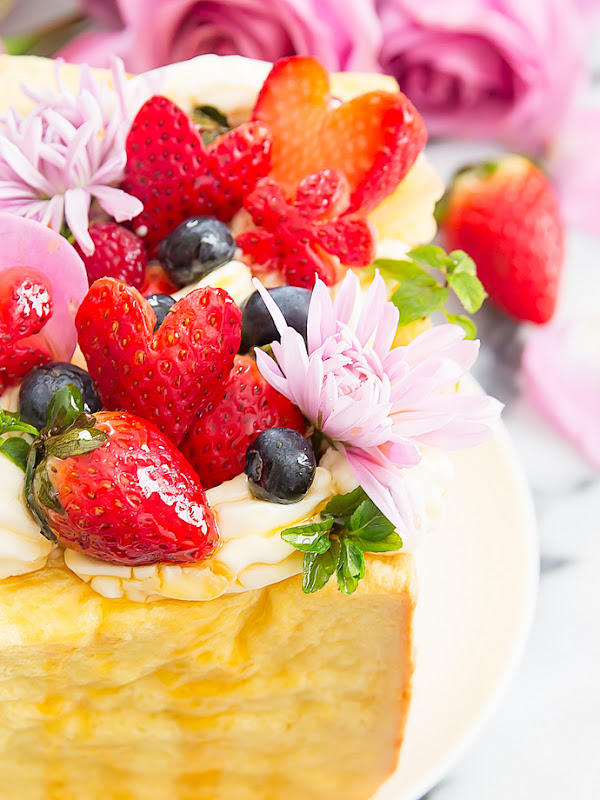 close-up photo of the fresh fruit and flowers on the french toast