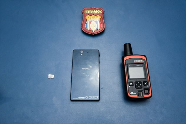 Police have now recovered the former headteacher Emma Kelty's GPS device, as well as a mobile phone and a memory card (pictured), which the gang of seven 'pirates' sold to local villagers after killing her. Photo: Daily Mail