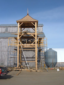 This mill-ruled frame rests on sleepers at two differnt elevations due to the tall grain bins along the front eave wall of this barn.