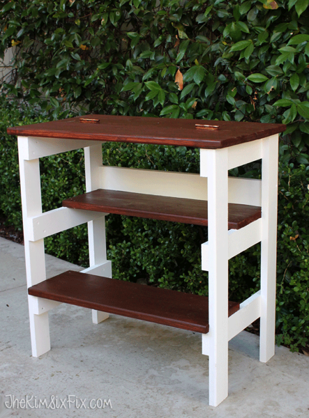Flip top table with multiple shelves