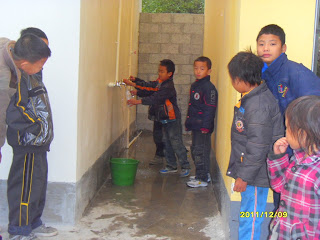 Students at Shang Mei Primary School get their first pure drink of water without boiling it.