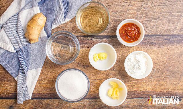 ingredients on a board: sugar, vinegar, water, ginger, garlic, chili sauce, cornstarch, scallions
