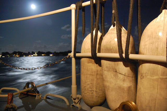 Poole all-weather lifeboat inside Poole Harbour under the light from a supermoon. 10 August 2014 Photo: RNLI Poole/Dave Riley