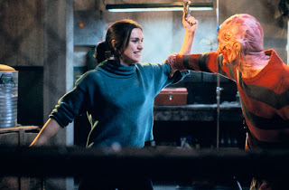 Maggie taunts Freddy with his glove.