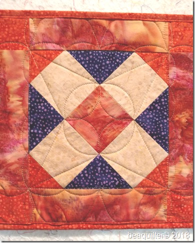 accuquilt batik table runner long arm quilting