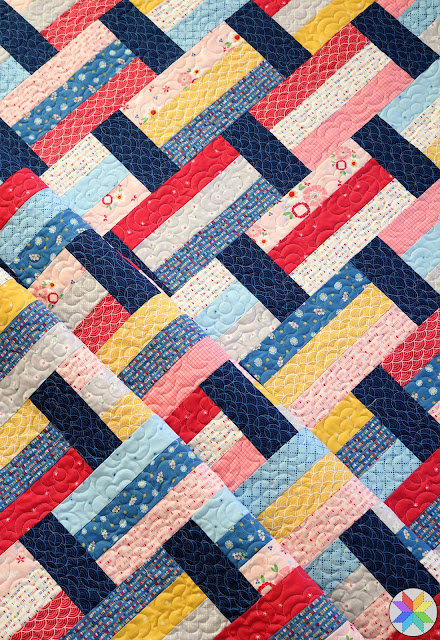 Fast Track quilt pattern by Andy of A Bright Corner - perfect for precuts like jelly roll strips or layer cake squares.  Also uses fat quarters - crib quilt lap quilt throw quilt and twin size quilt pattern