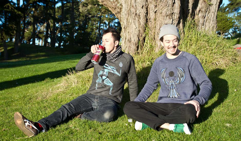 Graphic Sweatshirts: Jason drinks beer in grass