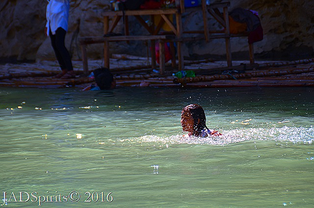 Our Daughter swimming with the current of Penaranda River at Minalungao National Park