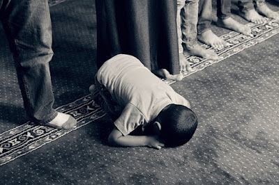 a muslim praying (observing solat)