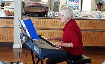 Mary Barrett playing her Korg Pa800.
