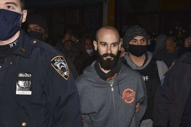 New York AP Top News Arrests Coronavirus pandemic New York City Sheriff: Defiant NYC bar owner struck deputy with his car