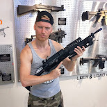 holding a SAW M249 machine gun at lock & load Miami in Miami, Florida, United States