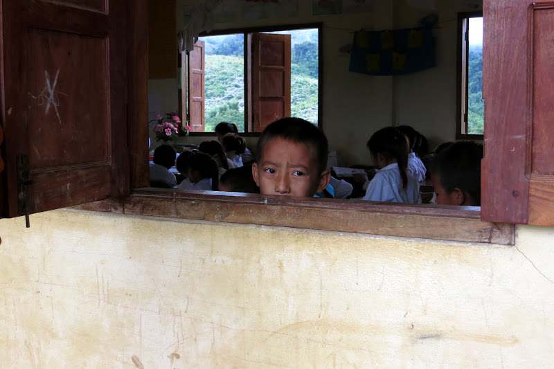 Boy looking out the window of his classroom
