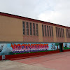 Creación de un Grafitti con motivos deportivos en el lateral del Pabellón del IES Campanillas.