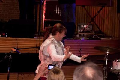 Marsha Feinstein dancing as the Tim O'Donohue and the TMU band plays.