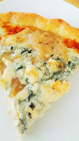 Blue Thyme pizza by Dove Vivi with that famous cornmeal crust and blue cheese, mozzarella, caramelized yellow onions and thyme