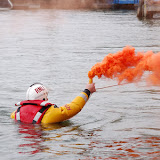 Crew member firing a hand-held distress flare, which crew carry on their lifejackets