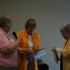 Alice HIx and Jean Gleaves present Gleaves books to Kegley Library