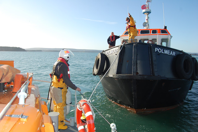 Crew members set up a tow line from the ALB to the broken down tug in Poole Harbour - Training exercise, 19 February 2012