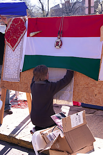 Monika hanging up some traditional Hungarian table cloths.