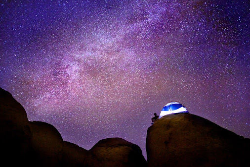 Tent under the Milky Way  I guess you could call this a selfie. Giant rock piles, my tent, and the milky...