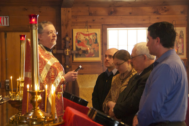 Fr. John presents a book of daily prayers to each.