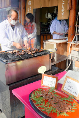Food around the outside of Fushimi Inari Shrine - Grilled Quail on skewers