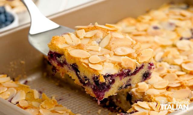 almond cake piece taken out of pan