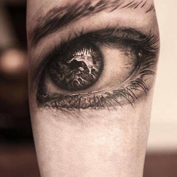 determinado_olho_braço_de_tatuagem