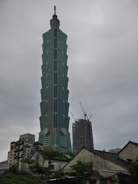 View  from Xinyi Public Assembly Hall (信義公民會館) of Taipei 101 on a cloudy early evening