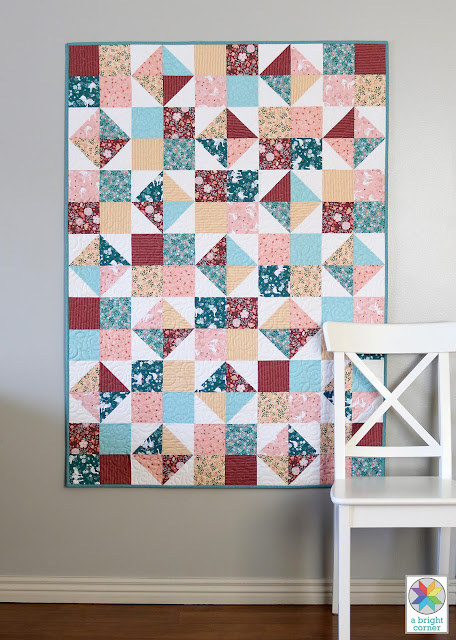 Four Patch Spin quilt pattern by Andy of A Bright Corner - a free download for an easy, fat quarter friendly lap size quilt