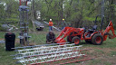 Craig N4OHE and the tower raising tractor, Mark K4SO and Rich K1HTV