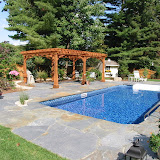 Stone Slab Pool Deck with Pergola
