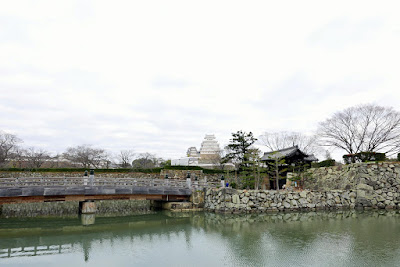 Himeji Castle, Japan - our first look once we walked down the main boulevard and crossed the last street into the park here. Also in the surrounding area are a garden and city zoo and what looked like an amusement park. The castle was originally encircled by three moats, of which two still survive