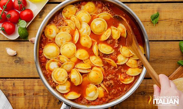 sausage and ravioli in a skillet