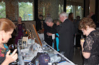Party guests eye items in the silent auction.