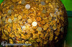 Wat Klong Prao, ball covered of gold and coins