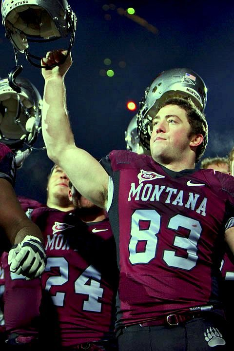 Brody McKnight celebrates as fireworks go off in the background.
