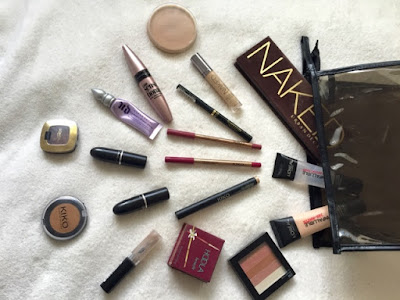 Travel makeup bag essentials