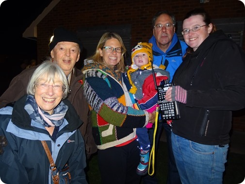 Harry Baxter with mother and representatives from  Gekostar Fireworks and Wistaston Community Council
