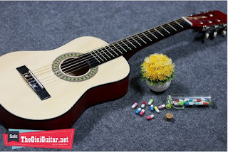 dan guitar mini co nho